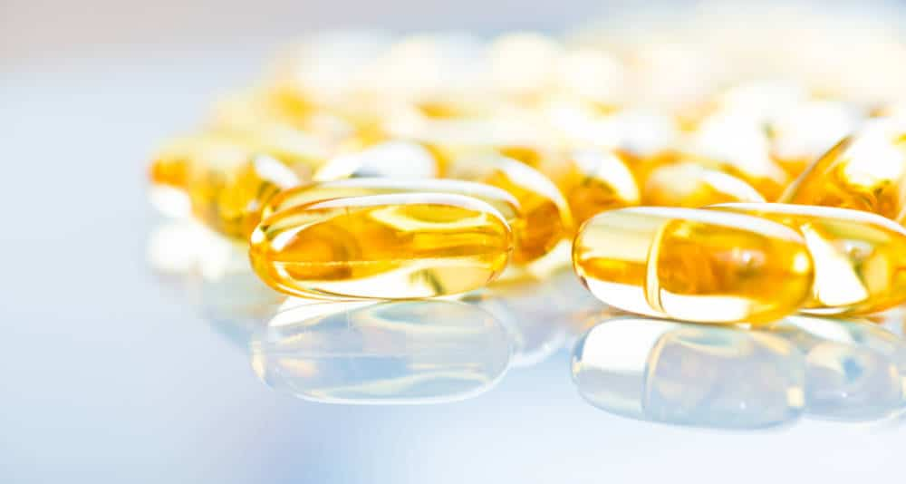 Closeup of fish oil capsules.