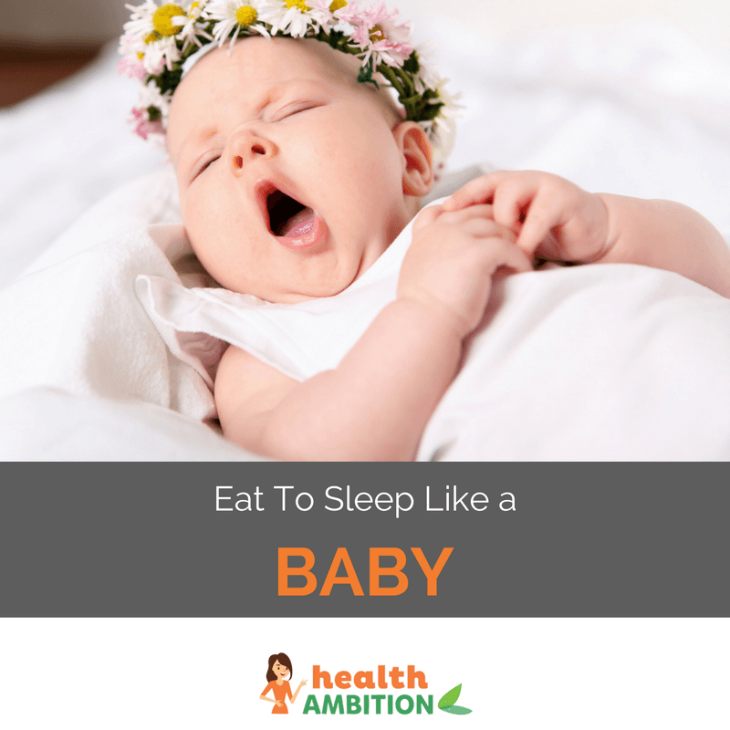 "A yawning baby in bed with the caption ""Eat to Sleep Like a Baby."""