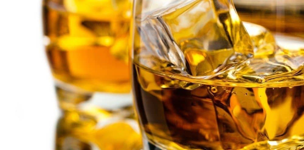 Close-up of a glass of liquor like whiskey or scotch.
