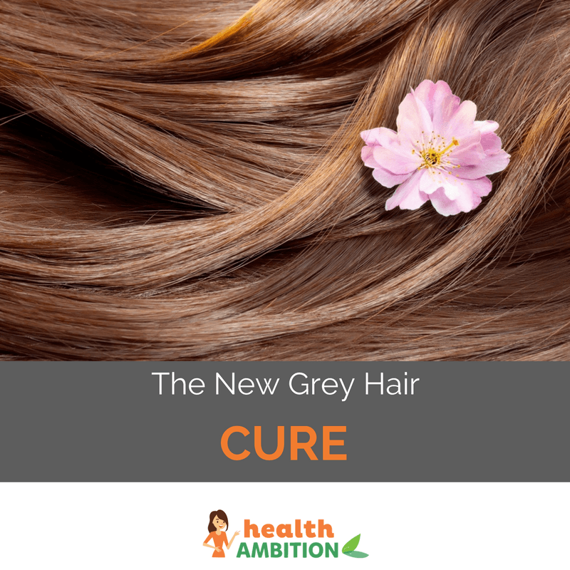 "Close-up of wavy brown hair with a smal lflower and the title ""The New Gray Hair Cure."""