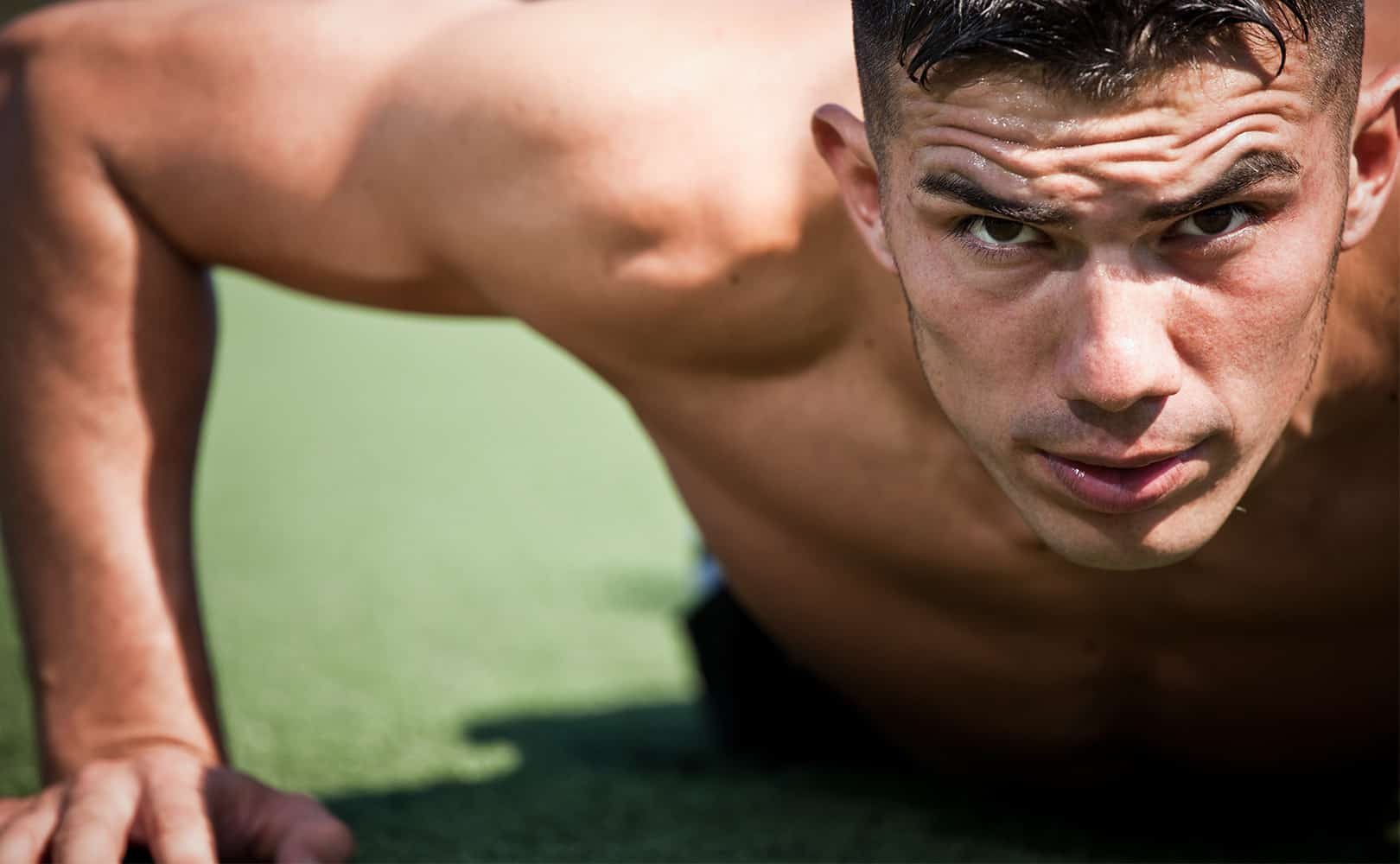 Man doing push-ups, on a quest to find out how to bulk up fast.