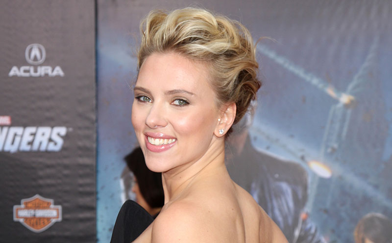 Close up of Scarlett Johansson's face on the red carpet of the premiere of the Avengers.