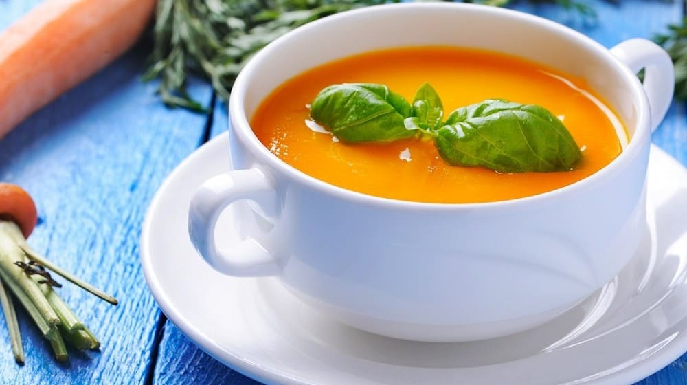 A cup of spicy carrot soup.
