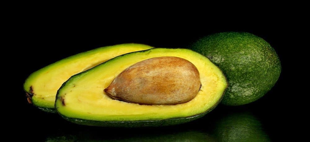An avocado sliced in half.