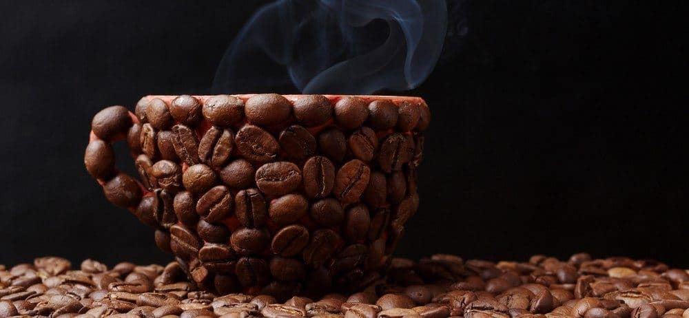 Coffee beans forming a coffee cup.