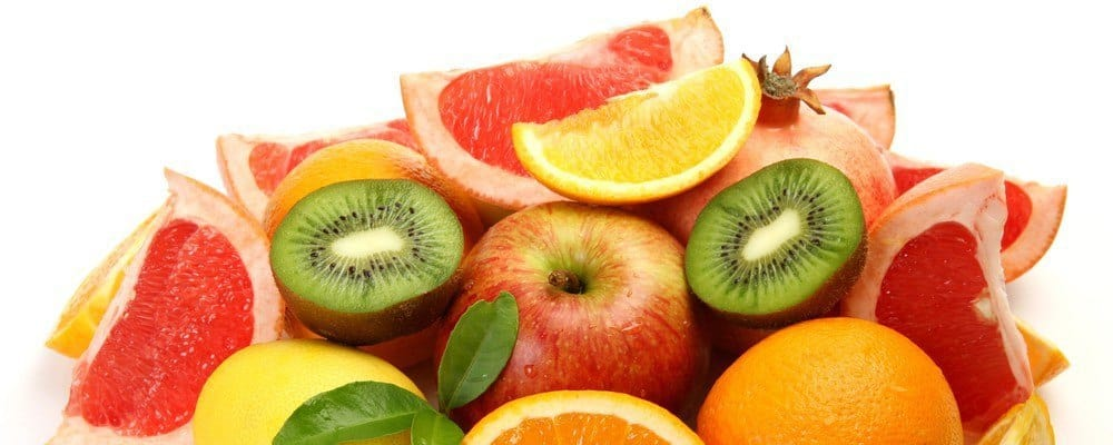 A bunch of sliced fruit (oranges, apples, kiwis).