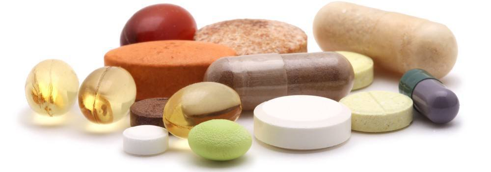 Vitamins of various shapes, colors, and sizes.