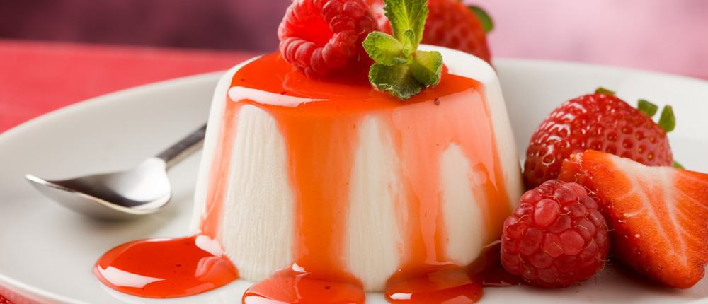 Panna cotta with strawberry syrup.