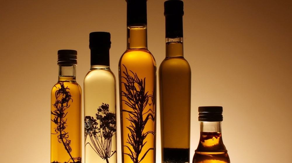 Silhouettes of five different types of bottled oils.