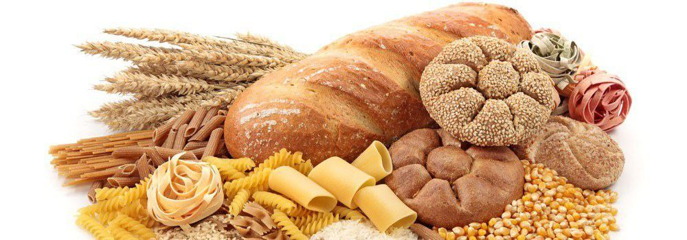 An image of foods containing carbohydrates such as pasta,, bread, corn, and others.