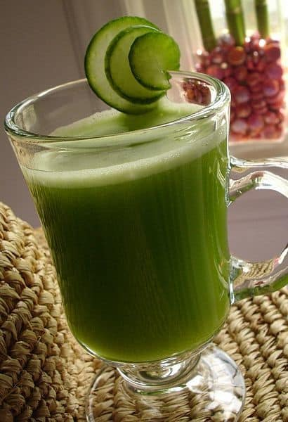 A glass of green cucumber and spinach.