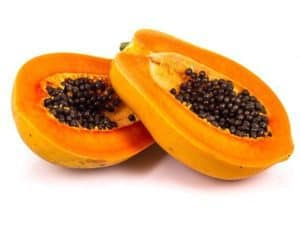 A halved papaya with seeds.