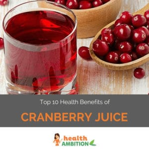 "A glass of cranberry juice with a spoonful of cranberries with the title ""Top 10 Health Benefits of Cranberry Juice."""