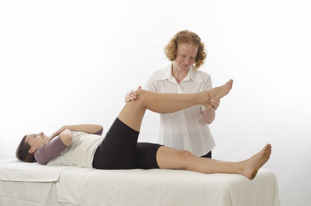 A physical therapist performing physical therapy.