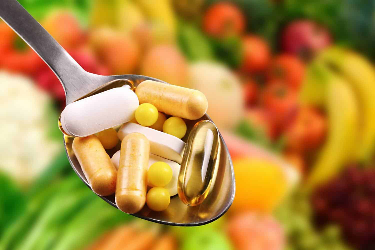 A spoonful of vitamin capsules.