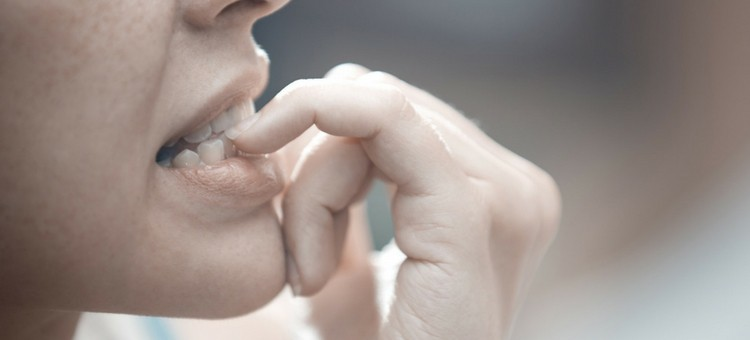A person biting her nails.