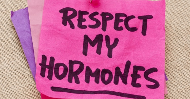 "A sticky note with ""Respect my Hormones"" written on it."