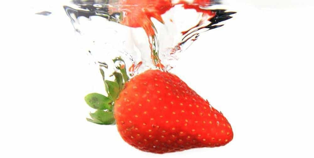 Strawberry fallen into water.