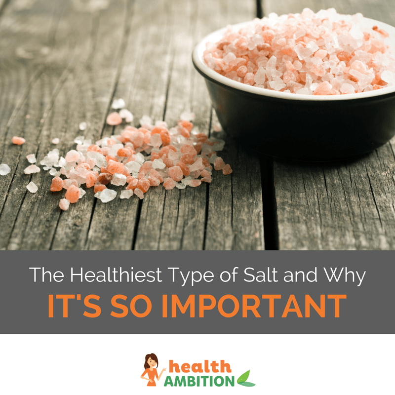 "A bowl of pink salt next to a small patch of the same salt on the floor with the title ""The Healthiest Type of Salt and Why It's So Important."""