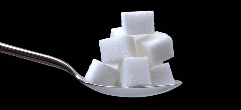 A spoonful of sugar cubes.