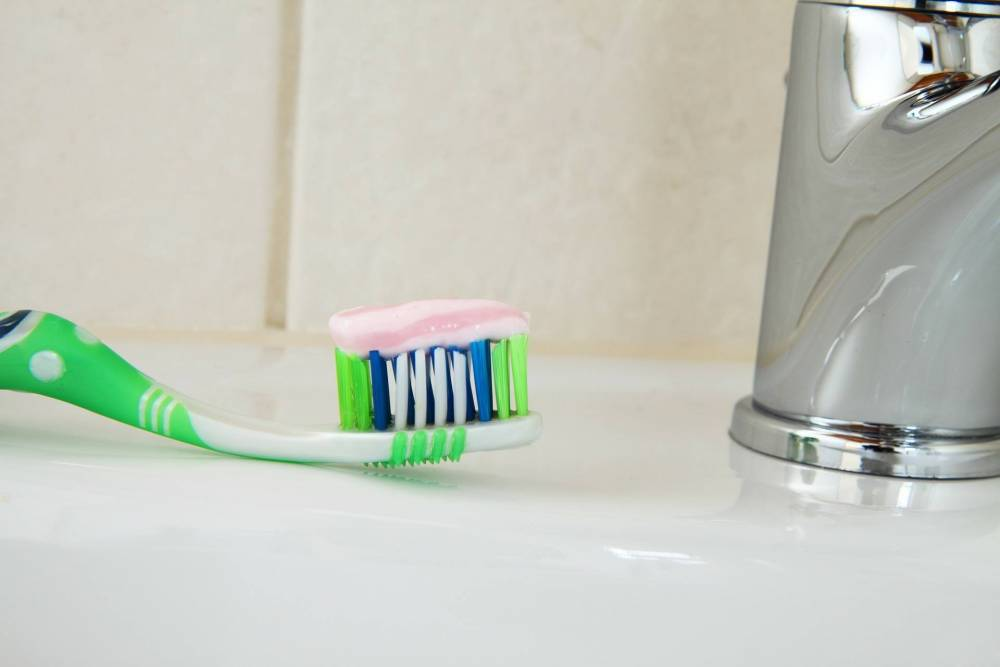 A toothbrush in a bathroom.