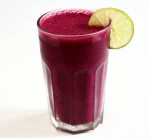 A glass of carrot and beet smoothie.