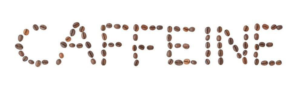 "The word ""caffeine"" made up of coffee beans."