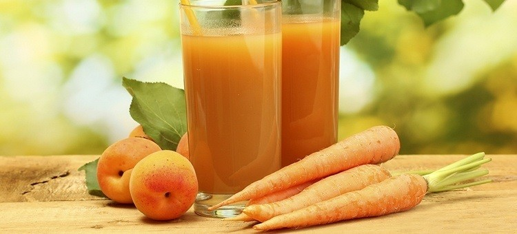Glasses of carrot-peach juice
