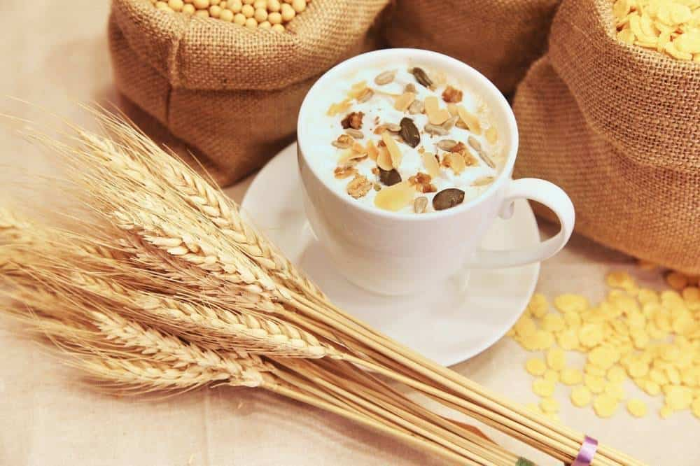 A cup of cereal with wheat.