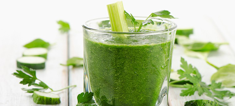 A glass of cucumber-celery smoothie.