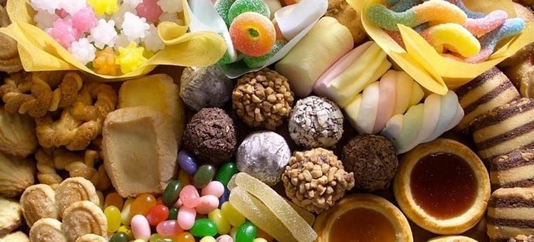 Various desserts and sweets like bonbons and jelly beans.