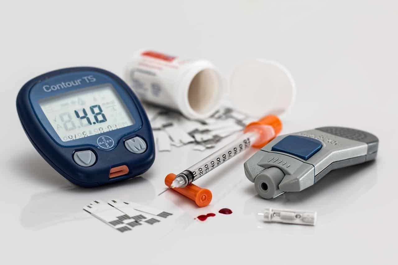 Various tools used by diabetes patients like insulin and a blood sugar monitor.