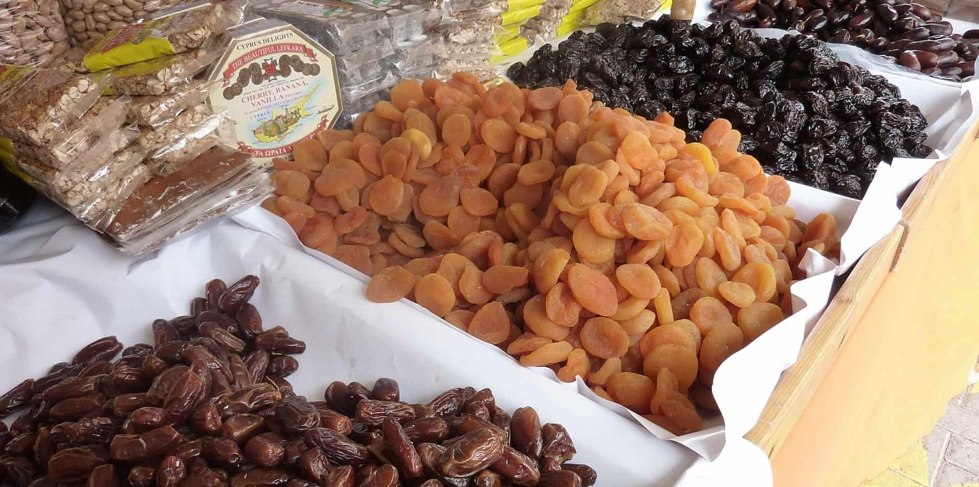 Dried fruit at a market stand.