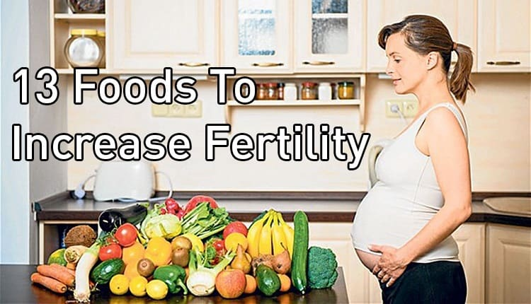 """A pregnant woman standing next to a table with the title """"13 Foods To Increase Fertility."""""""