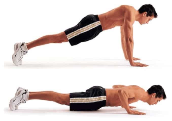 A man illustrating how to do a push up.