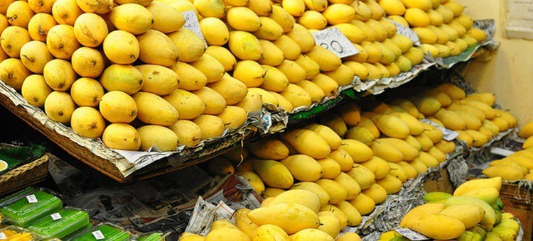Mangoes at the fruit section of a store.