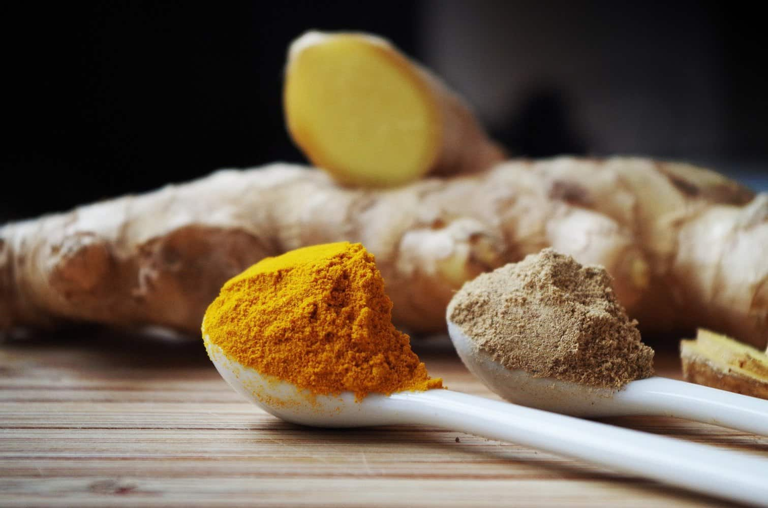 Ginger root and powder with turmeric powder.
