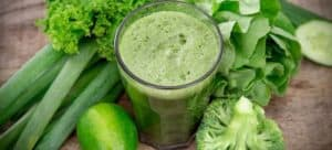 A green colored juice made mostly of leafy green veggies.