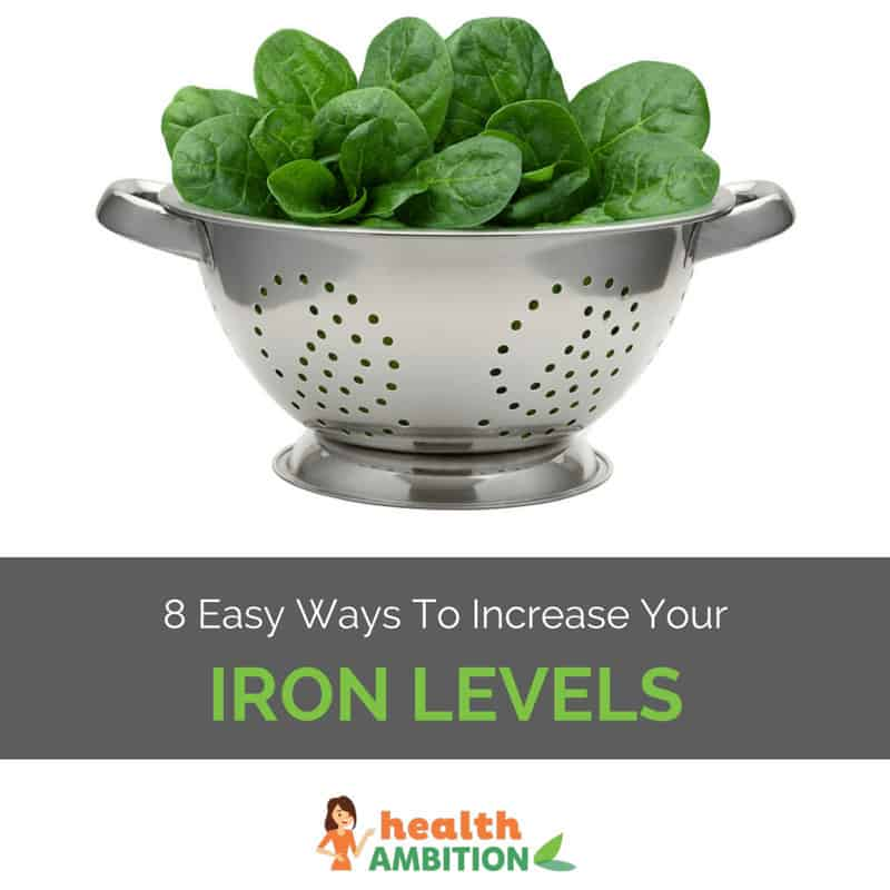 "Spinach in a colander with the title ""8 Ways to Increase Your Iron Levels."""