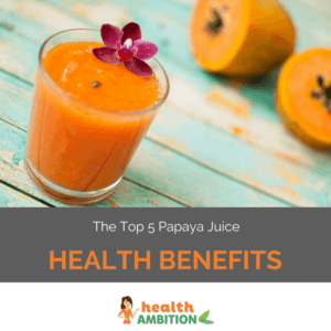 "A glass of papaya juice with a flower decoration next to halved papayas with the title ""The Top 5 Papaya Juice Health Benefits."""
