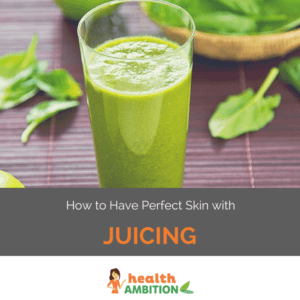 "A glass of green juice with leaves in the background with the title ""How to Have Perfect Skin with Juicing."""