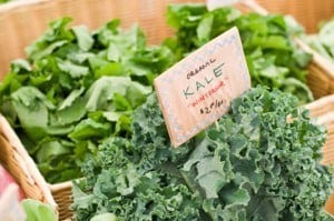Kale at a market with a note.