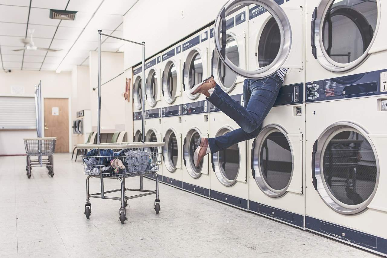 Person in a laundromat.