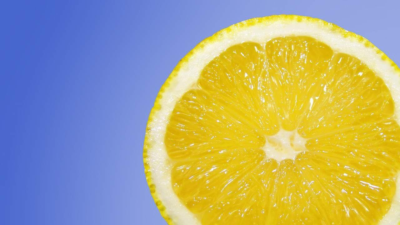 A slice of lemon with a blue background.
