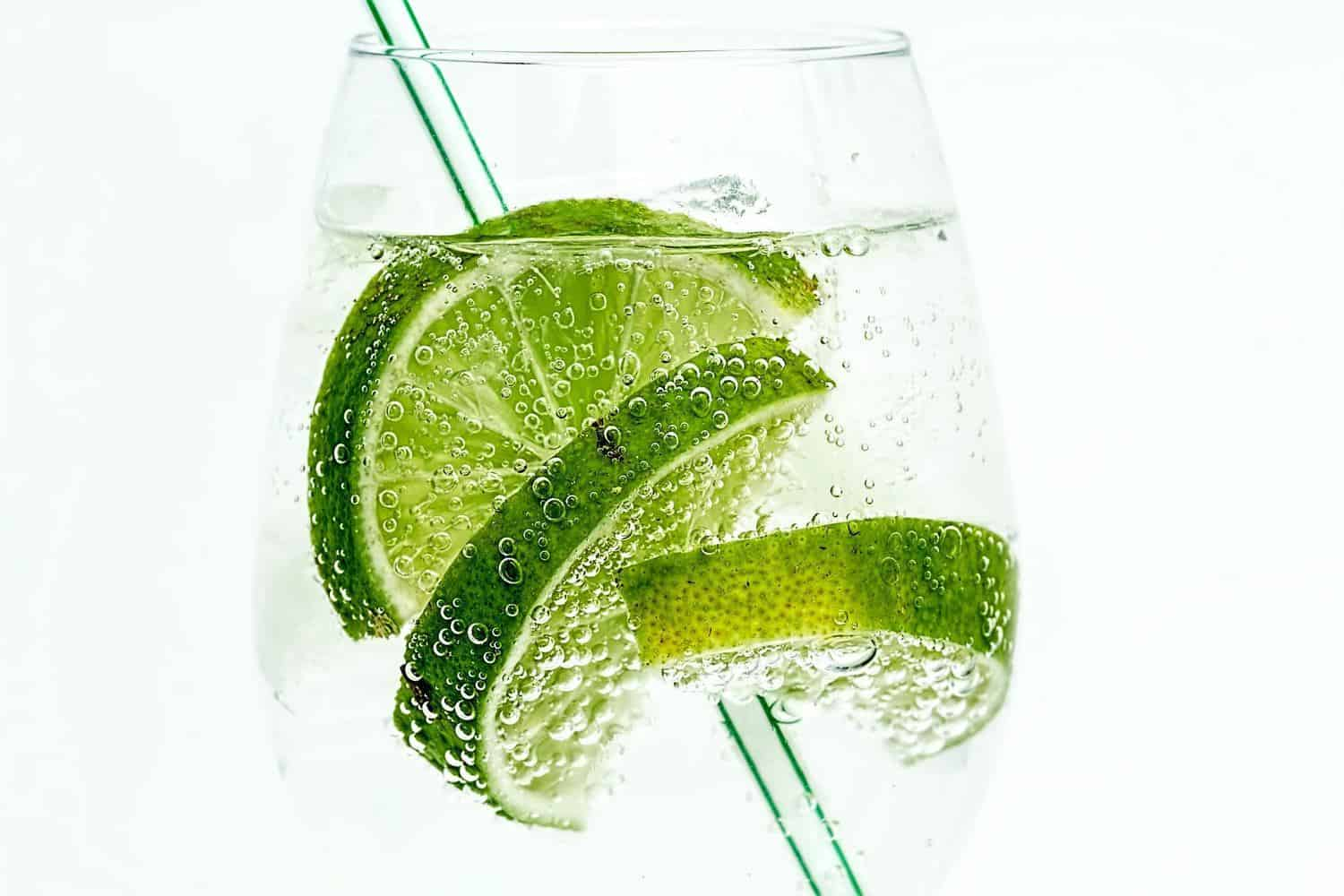 A glass of gin and lime.