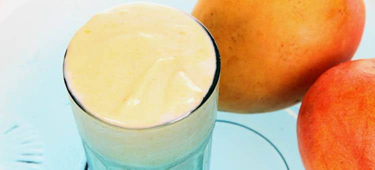 A glass of mango yogurt smoothie