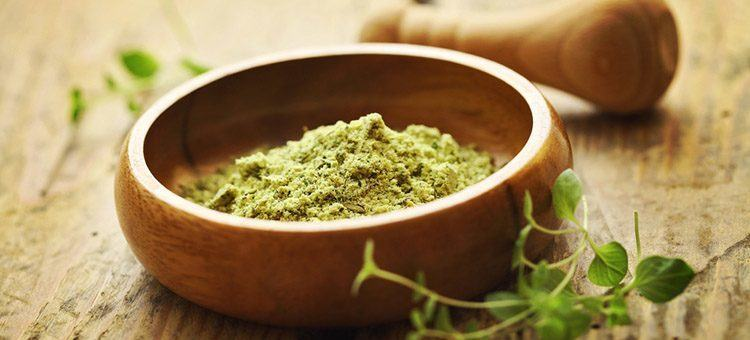 A bowl of green matcha powder.