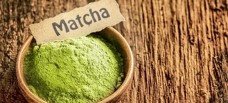 A small cup of matcha powder
