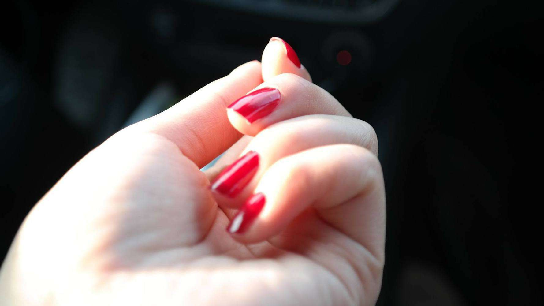 A person's nails with polish on them.