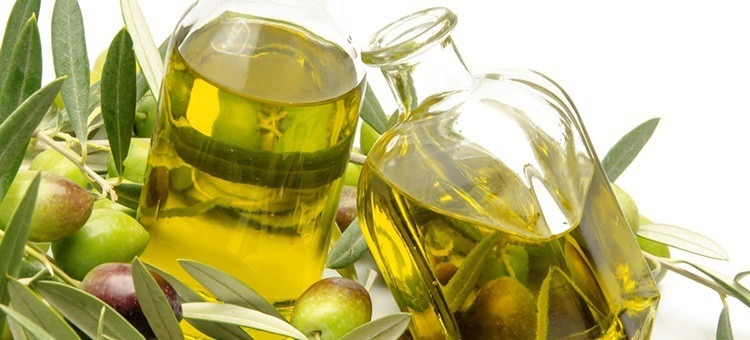 Two bottles of olive oil.